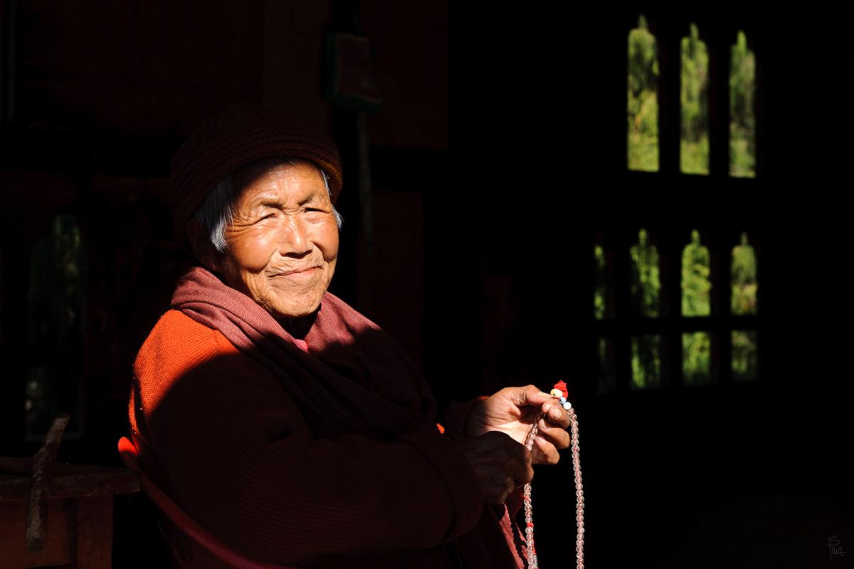 Bhutanese woman inside a monastery, Thimphu